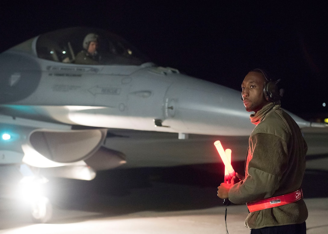 An Airman assigned to the 20th Maintenance Squadron, 79th Aircraft Maintenance Unit, prepares to launch an F-16 Fighting Flacon fighter jet assigned to the 79th Fighter Squadron during Red Flag 19-1 at Nellis Air Force Base, Nev., Jan 29, 2019. Approximately 2,900 personnel from the U.S. Air Force, U.S. Navy, Royal Air Force and Royal Australian Air Force will participate in the in the three-week exercise. (U.S. Air Force photo by Airman 1st Class Bryan Guthrie)
