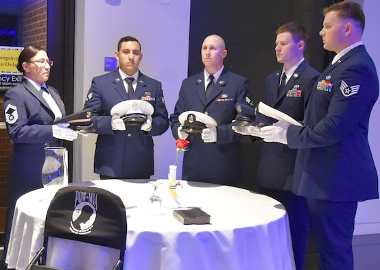 Citizen Reserve Airmen set the prisoners of war/missing in action table during the 2019 Annual Awards Banquet at the Wichita Art Museum, Feb. 2, 2019.  The tradition of setting a separate table in honor of prisoners of war and missing comrades has been in place since the end of the Vietnam War.