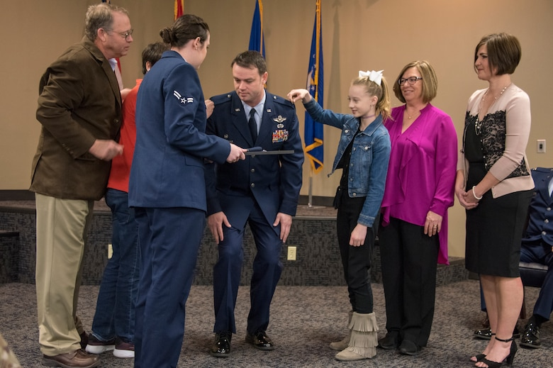 Col. Jeremiah S. Gentry, 188th Operations Group commander, has his new rank pinned on by friends and family during his promotion ceremony at Ebbing Air National Guard Base, Fort Smith, Ark., Feb. 2, 2019. Gentry has been a 188th Wing member since 2011 and was instrumental in the establishment of its MQ-9 remotely piloted aircraft mission. (U.S. Air National Guard photo by Tech. Sgt. Daniel Condit)
