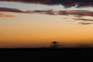 A C-17 Globemaster III takes off for Mountain Home Air Force Base, Idaho at dusk, Jan. 31, 2018 at Luke Air Force Base, Ariz.