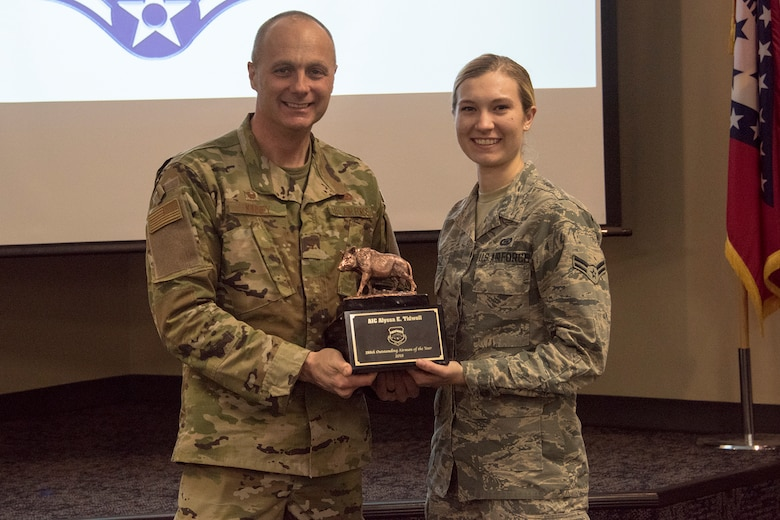 Col. Robert I. Kinney, 188th Wing commander, presents Airman 1st Class Alyssa E. Tidwell, the 188th Wing Outstanding Airman of the Year, with a trophy at a commander's call held at Ebbing Air National Guard Base, Ark., Jan. 13, 2019. (U.S. Air National Guard photo by Tech. Sgt. John E. Hillier)
