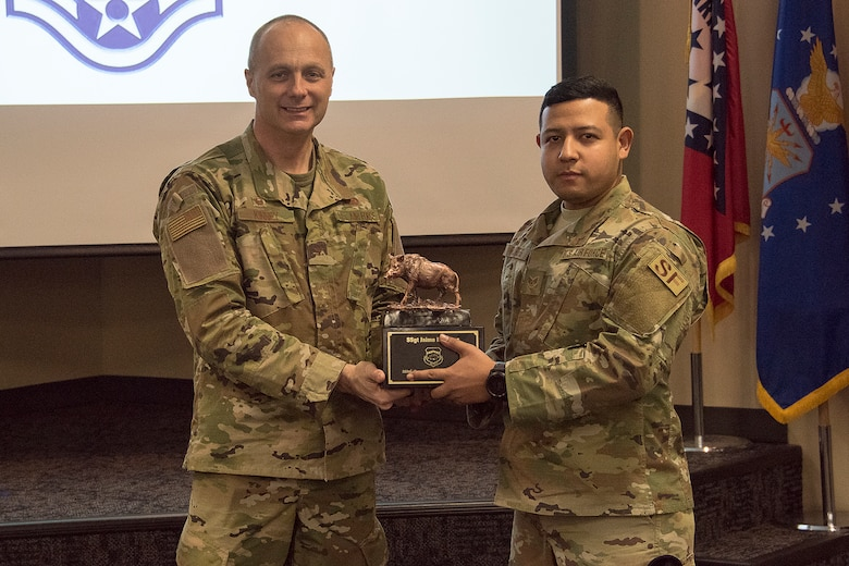 Col. Robert I. Kinney, 188th Wing commander, presents Staff Sgt. Jaime Flores, the 188th Wing Outstanding NCO of the Year, with a trophy at a commander's call held at Ebbing Air National Guard Base, Ark., Jan. 13, 2019. (U.S. Air National Guard photo by Tech. Sgt. John E. Hillier)