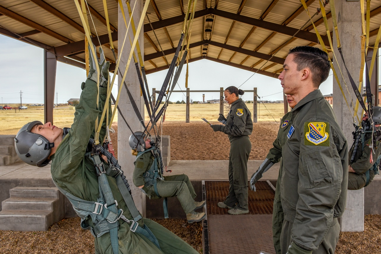 Airmen learn how to use parachutes.