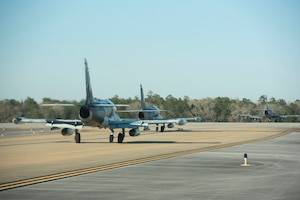Three L-159 Honeybadgers taxi down the flightline for training on Jan. 24th, 2019, at Eglin Air Force Base, Fla.
