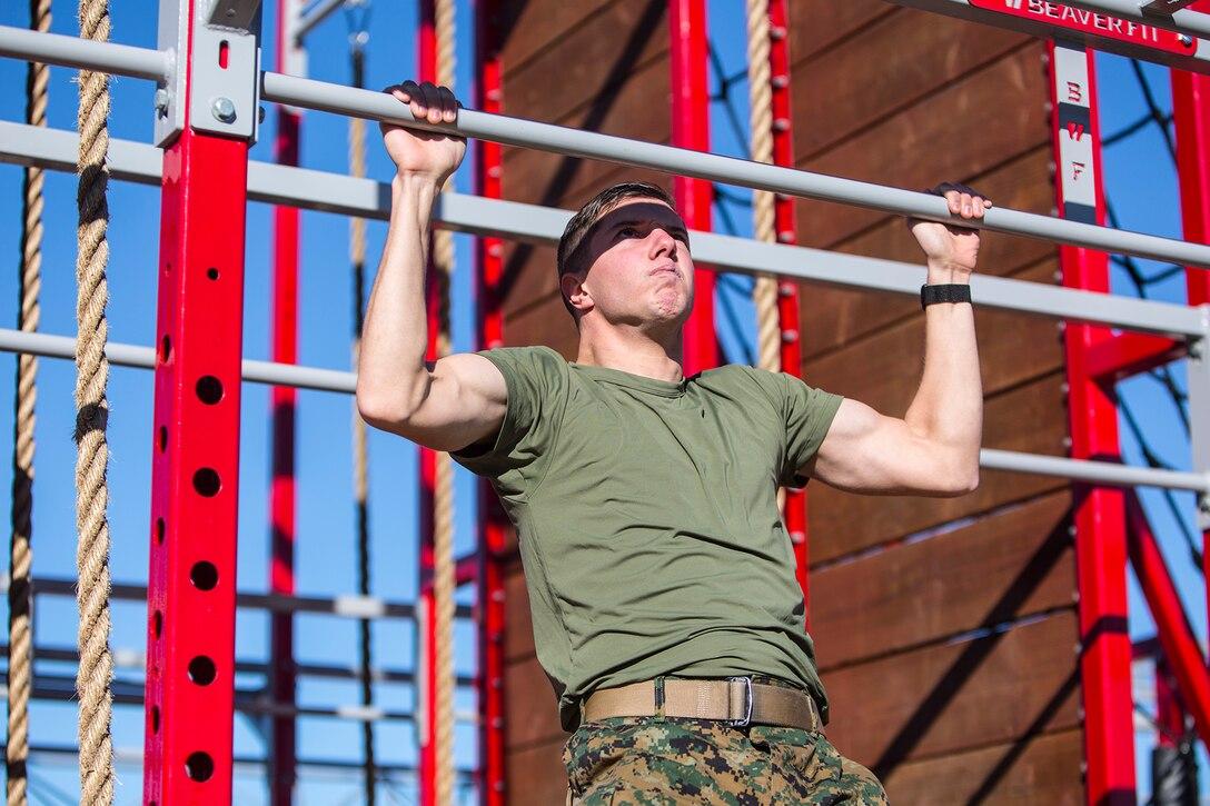 A Marine does pullups.