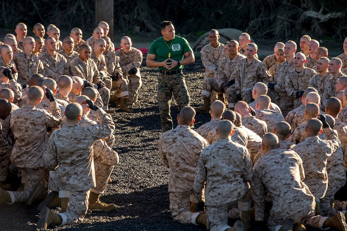 Staff Sgt. Eduardo Rodriguez, drill instructor, with Instructional Training Company, Support Battalion, briefs the recruits of Echo Company, 2nd Recruit Training Battalion, during a Marine Corps Martial Arts Program session at Marine Corps Recruit Depot San Diego, Jan. 23.