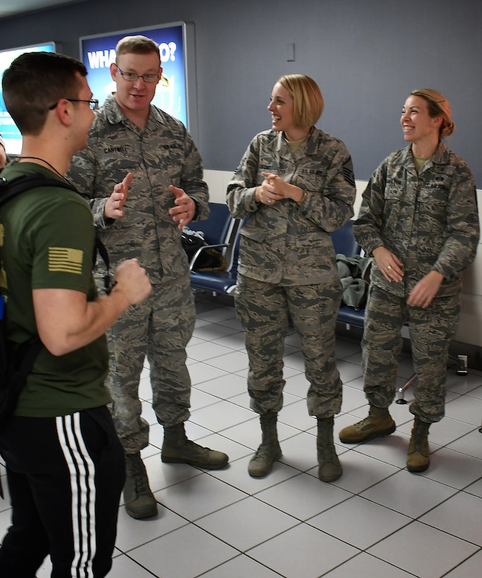 932nd Airlift Wing members were on hand to welcome back several Airmen recently, including deployer, Senior Airman Tyler Hambidge, at left, from the 932nd Medical Group. Giving him a verbal welcome upon arrival back in Illinois on January 29, 2019, is Senior Master Sgt. Wayne Cantwell, the superintendent of the 932nd MDG. The 932nd AW is an Air Force Reserve Command unit located at Scott Air Force Base, Illinois.  The mission of the wing is to provide unrivaled mission ready Citizen Airmen, and they come to train in Illinois from 37 different states.  (U.S. Air Force photo by Lt. Col Stan Paregien)