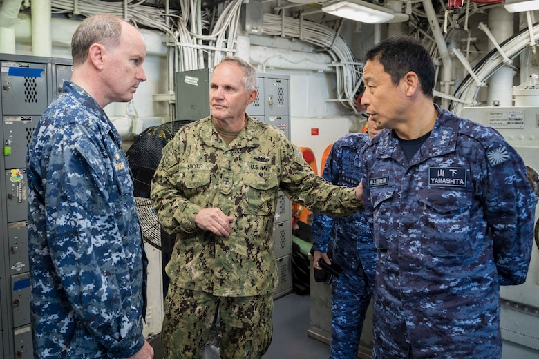 EAST CHINA SEA (Feb. 5, 2019) Commander of U.S. 7th Fleet, Vice Adm. Phil Sawyer (center), and Commander in Chief of Self Defense Fleet, Japan Maritime Self Defense Force (JMSDF), Vice Adm. Kazuki Yamashita (right) meets with the Commanding Officer of the amphibious assault ship USS Wasp (LHD 1), Capt. Colby Howard, during a visit between U.S. and Japan military officials to observe amphibious operations at sea. Wasp, flagship of the Wasp Amphibious Ready Group, with embarked 31st Marine Expeditionary Unit, is operating in the Indo-Pacific region to enhance interoperability with partners and serve as a ready-response force for any type of contingency.