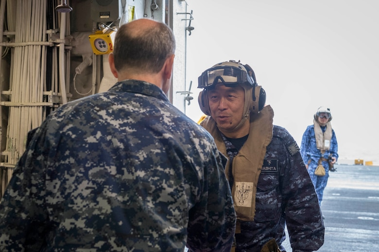 EAST CHINA SEA (Feb. 5, 2019) Commander in Chief of Self Defense Fleet, Japan Maritime Self Defense Force (JMSDF), Vice Adm. Kazuki Yamashita meets with the Commanding Officer of the amphibious assault ship USS Wasp (LHD 1), Capt. Colby Howard, during a visit between U.S. and Japan military officials to observe amphibious operations at sea. Wasp, flagship of the Wasp Amphibious Ready Group, with embarked 31st Marine Expeditionary Unit, is operating in the Indo-Pacific region to enhance interoperability with partners and serve as a ready-response force for any type of contingency.