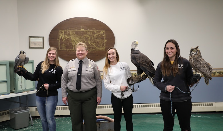 "On the premises of the Lewis & Clark and Gavins Point Dam as part of the ""Bald Eagle Days"" USACE hosts annually. Park Ranger Karla Zeutenhorst introduces raptor rehabilitators from Saving Our Avian Resources (S.O.A.R), who provide a demonstration involving an owl, a peregrine falcon and a bald eagle Feb. 3, 2019. (Photo by Dr. Michael Izard-Carroll, USACE Omaha PAO)"