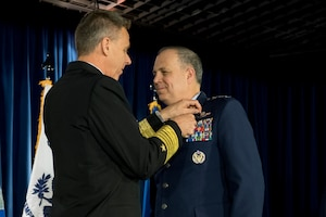 U.S. Navy Adm. Philip S. Davidson, commander, U.S. Indo-Pacific Command, presents U.S. Air Force Lt. Gen Jerry P. Martinez with the Defense Distinguished Service Medal during the United States Forces Japan and 5th Air Force change of command ceremony at Yokota Air Base, Japan, Feb. 5, 2019. During the ceremony, U.S. Air Force Lt. Gen. Kevin B. Schneider assumed command of USFJ and 5th AF from Martinez. (U.S. Air Force photo by Senior Airman Donald Hudson)