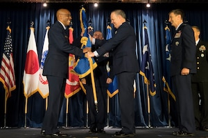 U.S. Air Force Lt. Gen. Jerry P. Martinez, (right), relinquishes command of 5th Air Force and passes the guidon to U.S. Air Force Gen. CQ Brown, Jr., commander, Pacific Air Forces (left), during the United States Forces Japan and 5th AF change of command ceremony at Yokota Air Base, Japan, Feb. 5, 2019. The passing of the guidon marks the end of Martinez's tour as the commander of the USFJ. (U.S. Air Force photo by Senior Airman Donald Hudson)