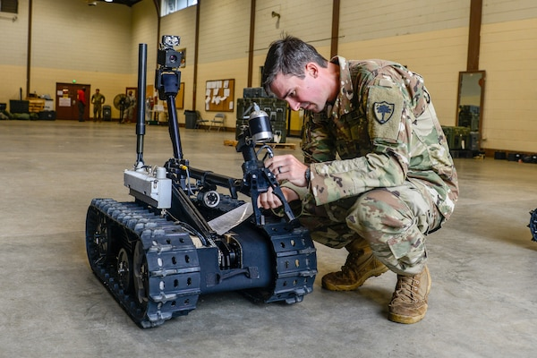 Army Staff Sgt. Kevin O'Conner, a combat engineer with the South Carolina Army National Guard's 122nd Engineer Clearance Company, examines parts of a Talon IV Reset robotic vehicle while conducting training at the unit's home station in Graniteville, S.C., in Oct. 2018.  In the coming years, Soldiers throughout the Army National Guard can expect to see a wider variety of robots with expanded capabilities to meet a number of missions sets. That may  include a golf cart-sized robot designed to carry a squad's equipment as well as advances in autonomous vehicles that follow a lead vehicle driven by Soldiers.