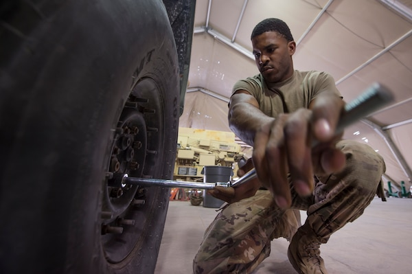U.S. Army Spc. Jaylyn Wilson Echo Company, 1st Battalion, 43rd Air Defense Artillery (ADA) Battalion, 11th ADA Brigade wheeled vehicle mechanic, prepares a military vehicle's tires for rotation as part of routine maintenance Jan. 28, 2019, at Al Udeid Air Base, Qatar. Soldiers of Echo Company perform mechanical work and repairs for various equipment and assets that support Al Udeid's air defense capabilities, including surface-to-air missile systems. (U.S. Air Force photo by Tech. Sgt. Christopher Hubenthal)