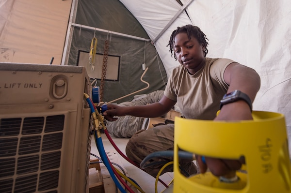 U.S. Army Spc. Shanikka Smith, Echo Company, 1st Battalion, 43rd Air Defense Artillery (ADA) Battalion, 11th ADA Brigade utilities equipment repairer, recovers refrigerant from a Patriot System's air conditioning unit compressor Jan. 28, 2019, at Al Udeid Air Base, Qatar. Soldiers of Echo Company perform mechanical work and repairs for various equipment and assets that support Al Udeid's air defense capabilities, including surface-to-air missile systems. (U.S. Air Force photo by Tech. Sgt. Christopher Hubenthal)