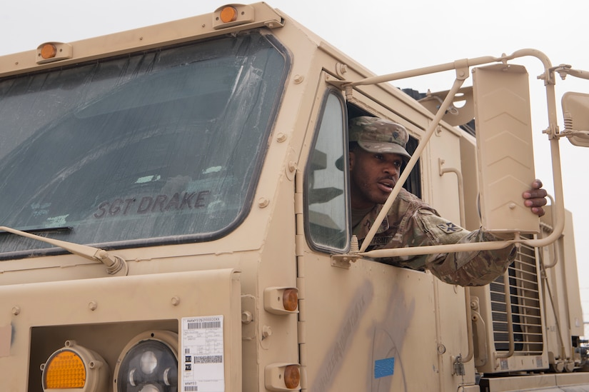 U.S. Army Spc. Jaylyn Wilson, Echo Company, 1st Battalion, 43rd Air Defense Artillery (ADA) Battalion, 11th ADA Brigade wheeled vehicle mechanic, conducts an operations check on a Palletized Load System truck Jan. 29, 2019, at Al Udeid Air Base, Qatar. Soldiers of Echo Company perform mechanical work and repairs for various equipment and assets that support Al Udeid's air defense capabilities, including surface-to-air missile systems. (U.S. Air Force photo by Tech. Sgt. Christopher Hubenthal)