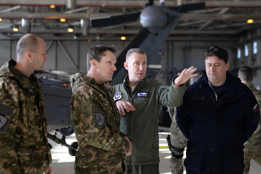 U.S. Air Force Col. Richard Nelson, 31st Operations Group commander, talks with a Slovenian Armed Forces leader about communication equipment, Jan. 22, 2019, at Aviano Air Base, Italy.