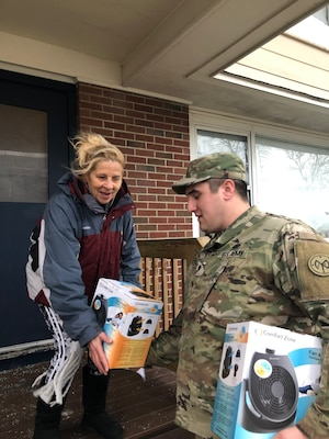 Members of the Rhode Island National Guard go door to door to inform and assist the community after a gas line issue left 7,000 homes in Newport and Middletown without heat on Thursday, January 24, 2019.  The Rhode Island National Guard was part of a multi-agency response to the incident after the Governor declared a state of emergency.  The RING went door to door to check on the health and welfare of the affected communities and keep them up to date as the repairs to the system progressed.  (U.S. Army National Guard photo by Capt. Mark Incze)
