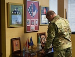 U.S. Army Maj. Gen. Robert E. Livingston, Jr., the adjutant general for South Carolina, looks over memorabilia and plaques in his office at the South Carolina Military Department headquarters in Columbia, South Carolina, Jan. 24, 2019. Livingston will retire in March 2019 after more than 40 years of military service and is the last popularly elected adjutant general in the nation.