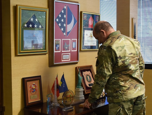 U.S. Army Maj. Gen. Robert E. Livingston, Jr., the adjutant general for South Carolina, looks over memorabilia and plaques in his office at the South Carolina Military Department headquarters in Columbia, South Carolina, Jan. 24, 2019.