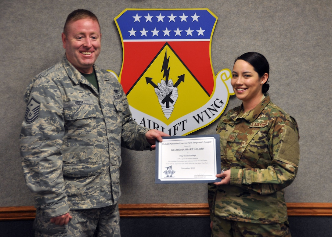 Master Sgt. Kevin Kelly, 445th Aerospace Medicine Squadron first sergeant, presents the November 2018 Diamond Sharp Award to Master Sgt. Jessica Hodge, 445th Logistics Readiness Squadron logistics planner, during the January 5, 2019 unit training assembly. The award is for exemplary performance, adherence to the Air Force Core Values, attitude, appearance and ability.