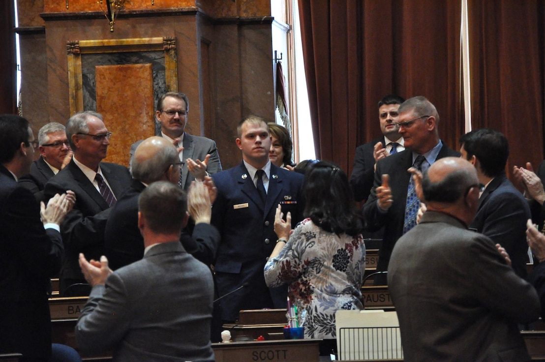 Airman 1st Class Josiah Reeves, cyber transport with the 132d Intelligence Support Squadron (ISS), is recognized by multiple representatives during the Eighty-Eighth General Assembly at the Iowa State Capitol on January 17th, 2019. Reeves was recognized for joining the Air National Guard to take advantage of the Science, Technology, Engineering, and Math (STEM) opportunities and utilizing the tuition assistance. (Iowa National Guard photo by Lt. Col. Timothy Mills)