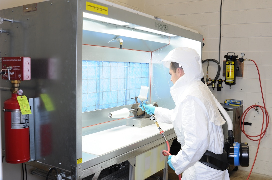 A.J. Spicer, an engineer at AEDC Hypervelocity Tunnel 9 in White Oak, Maryland, uses the facility's new Temperature-Sensitive Paint Application Lab to apply a coating of TSP to a test article. The lab has been operational since spring of 2018. Unused space at Tunnel 9 was converted to make way for the lab, which is used to both apply TSP to wind tunnel test articles and continue the development and refinement of TSP formulations and application techniques.