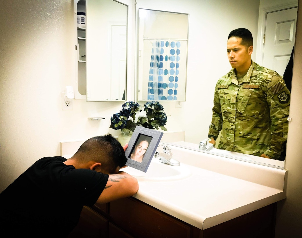 "Master Sgt. Christofer Galbadores, 821st Contingency Response Support Squadron security forces training and logistics superintendent at Travis Air Force Base, California, mourns the loss of his mother. Losing his mother tested Galbadores's faith and his perspective on life. ""Physically and mentally, recovery was rough,"" he said. ""During that journey I lost sight of a few things, but I did learn that sometimes you really have to know darkness to appreciate the light."" (Courtesy Photo Illustration)"