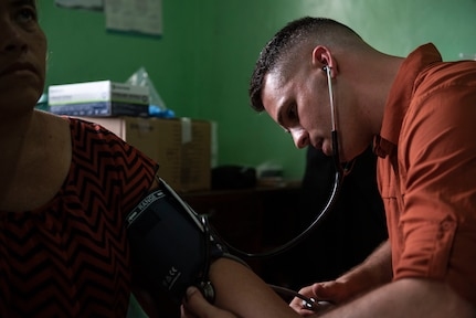 U.S. Army 1st Lt. Luke Emerson, Medical Element emergency room nurse, takes a patient's blood pressure during a medical readiness exercise in El Palmital, Honduras, Jan. 31, 2019.