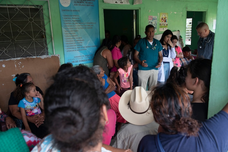 A doctor speaks to awaiting patients at a local clinic in El Palmital, Honduras, Jan. 31, 2019.