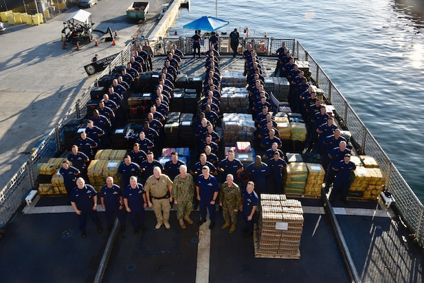 The Coast Guard Cutter Forward (WMEC-911) crew stand amongst 34,780 pounds of interdicted cocaine aboard at Port Everglades, Florida, Feb. 5, 2019