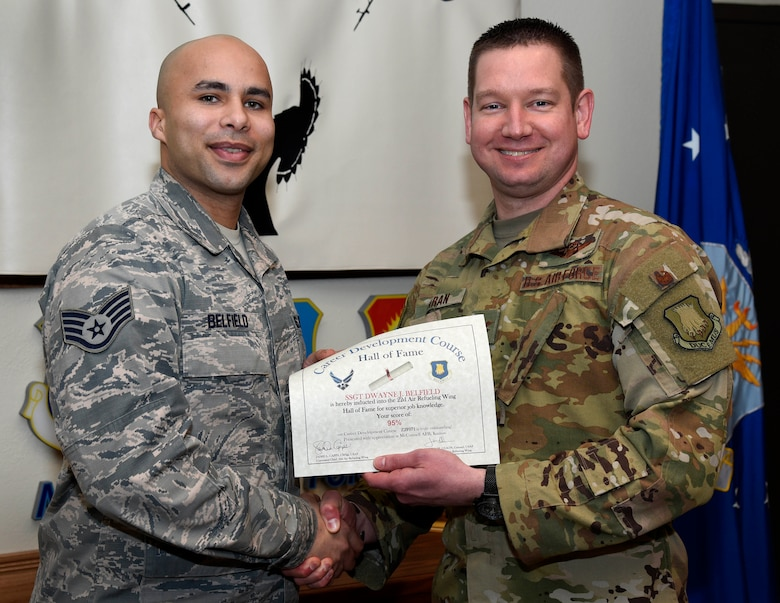 Staff Sgt. Dwayne Belfield, 22nd Logistics Readiness Squadron fuel service center controller, is recognized by Col. Mark Baran, 22nd Air Refueling Wing vice commander, for earning a score of 95 percent on his Career Development Course Feb. 5, 2019, at McConnell Air Force Base, Kan. CDCs help enlisted personnel complete the specialty knowledge portion of on-the-job training for their specific career fields.