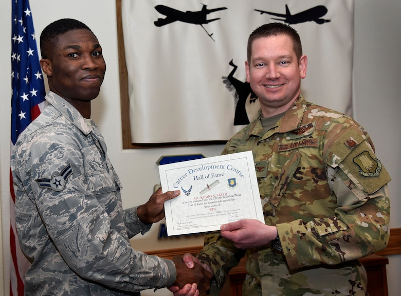 Airman 1st Class Kodjo Eklou, 22nd Logistics Readiness Squadron flight service center apprentice, is recognized by Col. Mark Baran, 22nd Air Refueling Wing vice commander, for earning a score of 98 percent on his Career Development Course Feb. 5, 2019, at McConnell Air Force Base, Kan. CDCs help enlisted personnel complete the specialty knowledge portion of on-the-job training for their specific career fields.