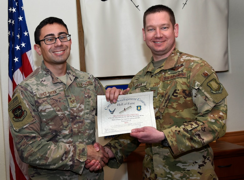 Senior Airman David Lopez-Rivera, 22nd Aircraft Maintenance Squadron guidance and control systems apprentice, is recognized by Col. Mark Baran, 22nd Air Refueling Wing vice commander, for earning a score of 95 percent on his Career Development Course Feb. 5, 2019, at McConnell Air Force Base, Kan. CDCs help enlisted personnel complete the specialty knowledge portion of on-the-job training for their specific career fields.