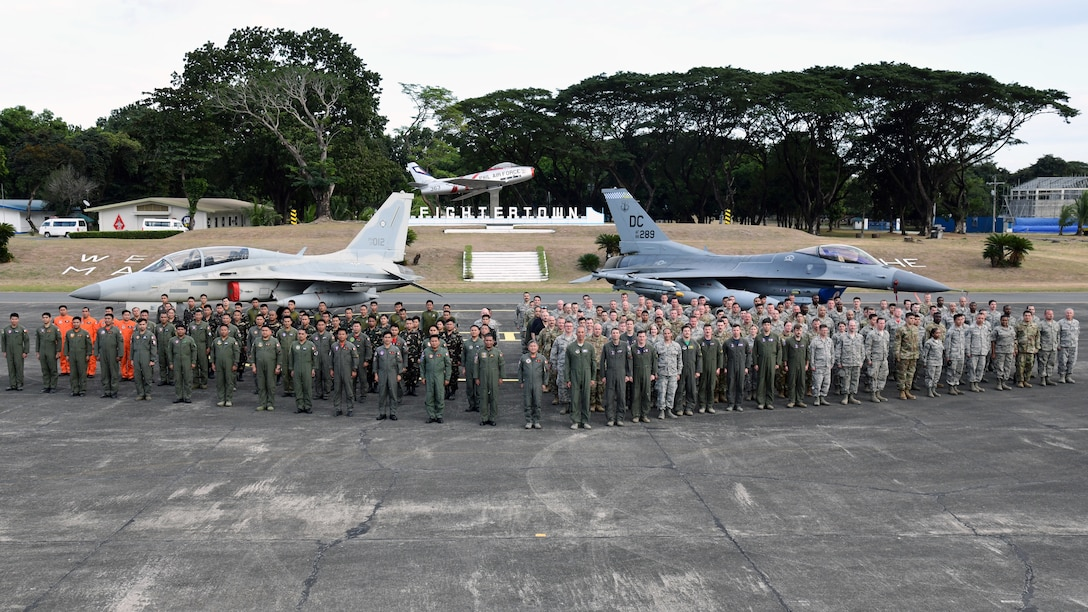 U.S. Air Force members pose alongside Philippine Air Force members during the Bilateral Air Contingent Exchange-Philippines (BACE-P) at Cesar Basa Air Base, Philippines, Feb. 1, 2019.