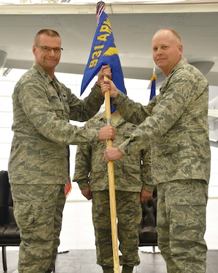 (Left to right) Col. Phil Heseltine, 931st Air Refueling Wing commander, takes the guidon from Col. Heath Fowler, the outgoing 931st Maintenance Group commander, during an official change of command ceremony, Feb. 3, 2019, McConnell Air Force Base, Kan. Fowler was the first commander of the 931 MXG, which stood up in 2016.