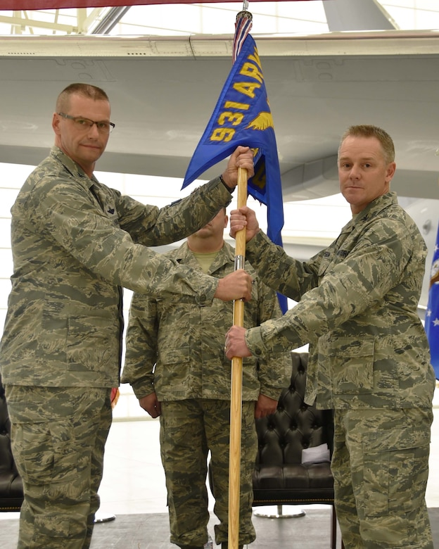 (Left to right) Col. Phil Heseltine, 931st Air Refueling Wing commander, hands the guidon to Col. Robert Thompson, the incoming 931st Maintenance Group commander, during an official change of command ceremony, Feb. 3, 2019, McConnell Air Force Base, Kan. As commander of the 931 MXG, Thompson is directly responsible for the training and readiness of more than 270 Reserve Citizen Airmen.