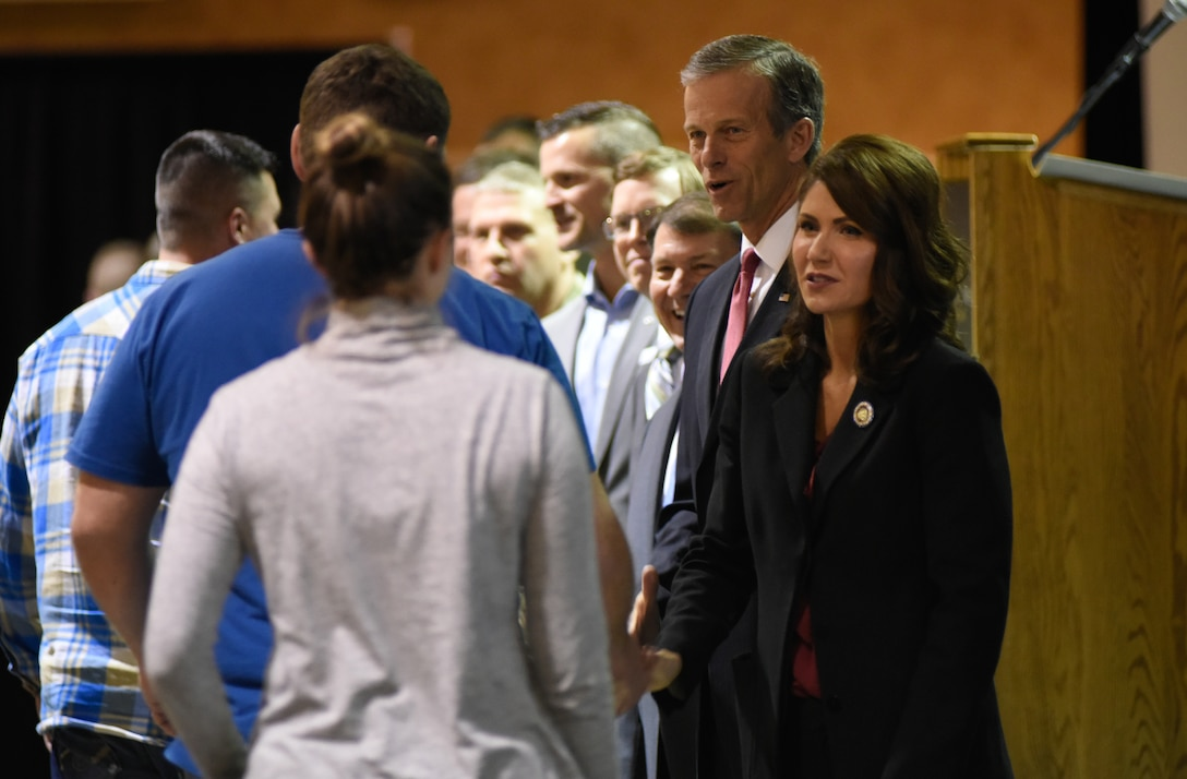 Gov. Kristi Noem, 33rd governor of South Dakota, along with the South Dakota Congressional Delegation and South Dakota National Guard senior leaders, shake the hands and officially welcome home members of the 114th Fighter Wing in Sioux Falls, S.D., Feb. 3, 2019.