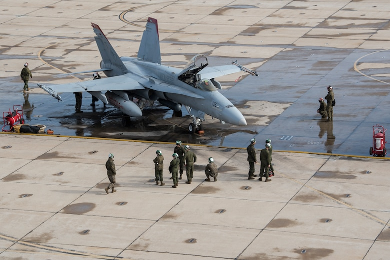 A U.S. Marine Corps F/A-18C Hornet and aircrew inspect the aircraft during joint exercise Winter Fury at Marine Corps Air Station Miramar, San Diego, Calif., Jan. 16, 2019. Winter Fury involved both Marine F/A-18C Hornets, and Navy F-35C Lightning II's, partnering with Air Force F-22 Raptors to perform air-to-air combat, while protecting ground assets.