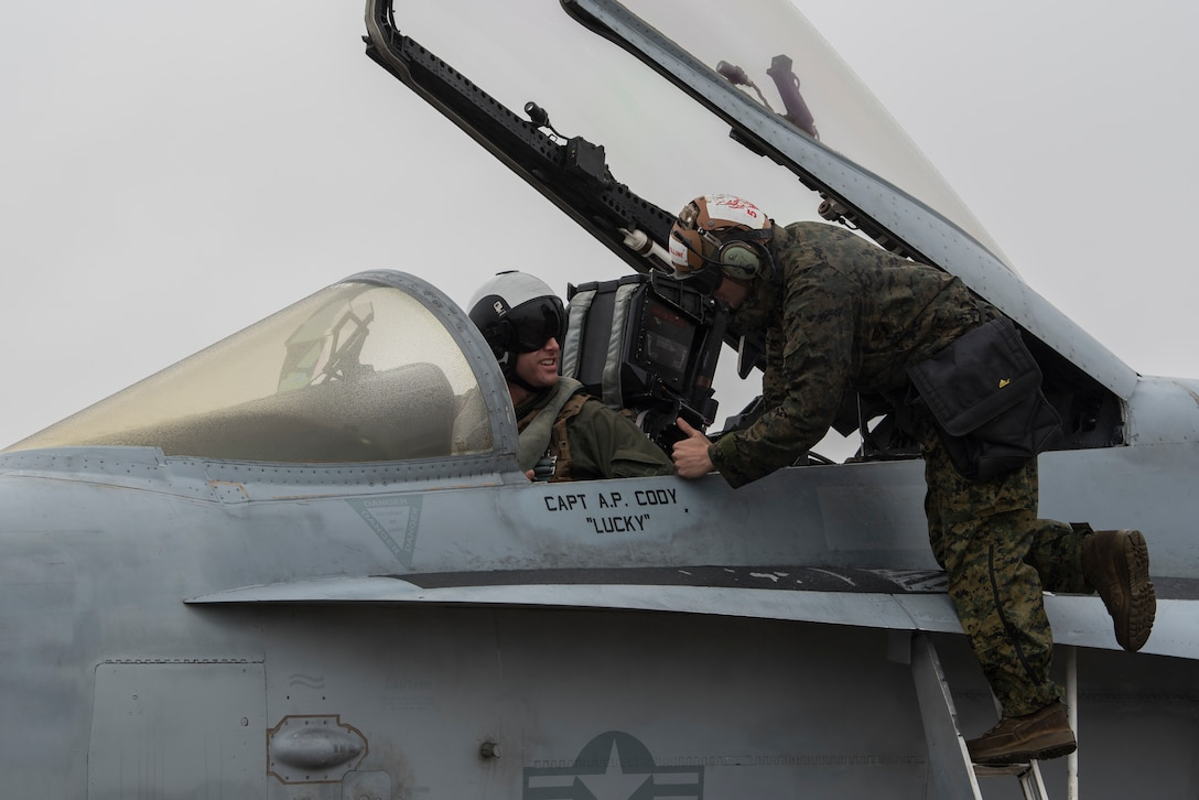 A U.S. Marine Corps F/A-18C Hornet pilot and crew chief talk before takeoff during joint exercise Winter Fury at Marine Corps Air Station Miramar, San Diego, Calif., Jan 17, 2019. Winter Fury involved both Marine F/A-18C Hornets, and Navy F-35C Lightning II's, partnering with Air Force F-22 Raptors to perform air-to-air combat, while protecting ground assets.