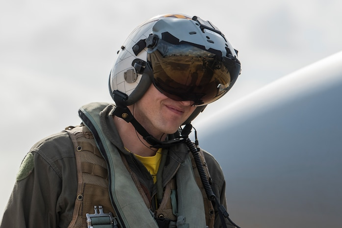 U.S. Marine Corps Maj. Matthew Andrews, 323nd Marine Fighter Attack Squadron pilot, walks to an F/A-18C Hornet during joint exercise Winter Fury at Marine Corps Air Station Miramar, San Diego, Calif., Jan. 18, 2019. Winter Fury involved both Marine F/A-18C Hornets, and Navy F-35C Lightning II's, partnering with Air Force F-22 Raptors to perform air-to-air combat, while protecting ground assets.