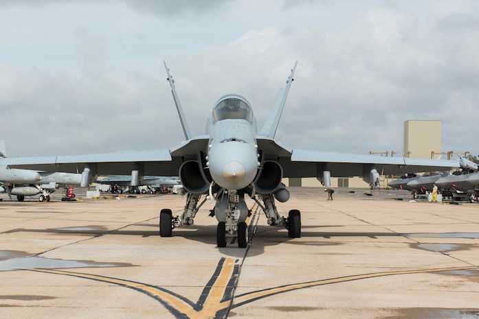 A U.S. Marine Corps F/A-18C Hornet taxis onto the runway during joint exercise Winter Fury at Marine Corps Air Station Miramar, San Diego, Calif., Jan. 18, 2019. Winter Fury involved both Marine F/A-18C Hornets, and Navy F-35C Lightning II's, partnering with Air Force F-22 Raptors to perform air-to-air combat, while protecting ground assets.