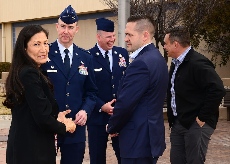 U.S. Congresswoman Deb Halland (D-New Mexico) talks with Col. Richard Gibbs, 377th Air Base Wing commander, and Kirtland leadership during a visit to Kirtland Air Force Base Feb. 5, 2019. Halland attended a briefing and visited key base locations during her visit. (U.S. Air Force photo by Jessie Perkins.)
