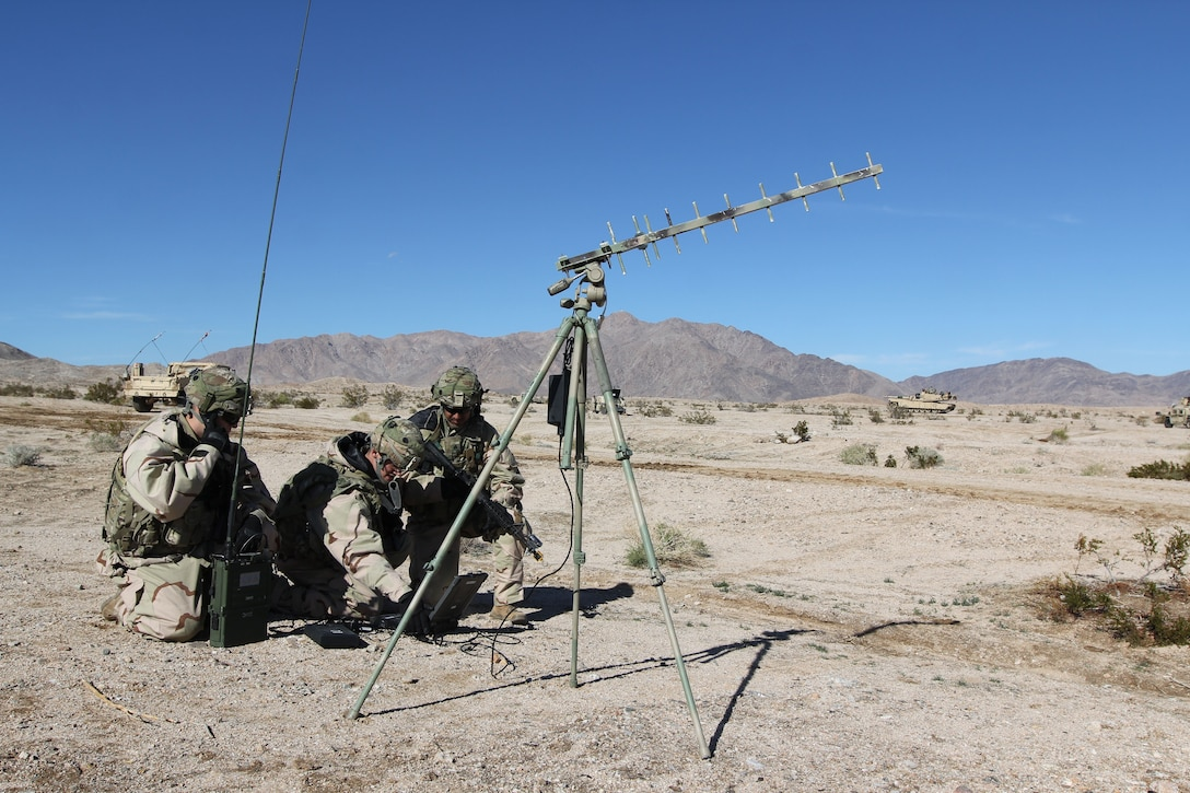 Soldiers set up cyberspace equipment.
