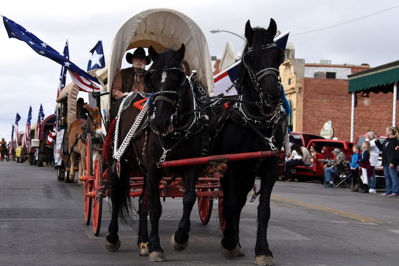 Old Fort Concho representatives lead the parade with horses, mules and buggies during the 87th annual San Angelo Stock Show and Rodeo Parade in downtown San Angelo Feb. 2, 2019. The parade kicked off the rodeo this year which will be taking place from Feb. 2-17, 2019. (U.S. Air Force photo by Senior Airman Seraiah Hines/Released)