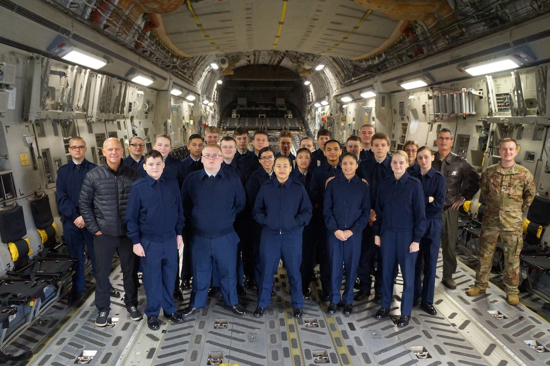 Bethel High School JROTC cadets pause for a group photo with Staff Sgt. Zack Epperson, 313th Airlift Squadron loadmaster, and former Bethel HS JROTC cadet, at McChord Field, Wash. The cadets got to experience an orientation flight on a C-17 Globemaster III in January. (Courtesy photo)