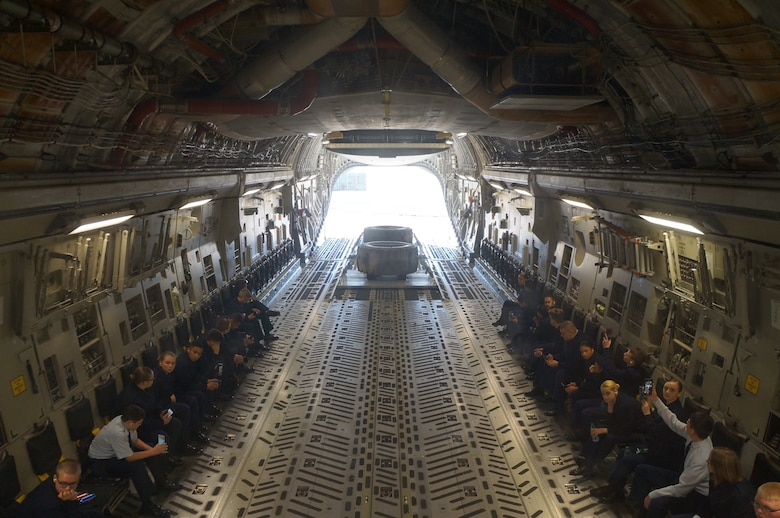Cadets with Bethel High School JROTC await for a combat offload demo on a C-17 Globemaster III in January at McChord Field. The cadets got to experience an orientation flight aboard the C-17 cargo aircraft. (Courtesy photo)