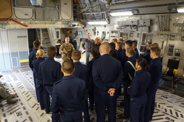 Staff Sgt. Zack Epperson, 313th Airlift Squadron loadmaster, gives a safety briefing to Bethel High School JROTC cadets prior to their recent orientation flight on McChord Field in January. (Courtesy photo)