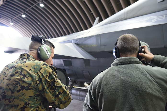 U.S. Marine Corps Sgt. Maj. Anthony Spadaro, U.S. Pacific Command senior enlisted leader, left, watches a 51st Maintenance Squadron crew chief perform pre-flight procedures at Osan Air Base, Republic of Korea, Jan. 28, 2019. During his tour of Osan, Spadaro observed how enlisted members performed their daily jobs and tasks. (U.S. Air Force photo by Airman 1st Class Ilyana A. Escalona)