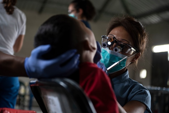 U.S. Army Maj. Margaret Novicio, Medical Element dentist, treats a patient during a medical readiness exercise in El Palmital, Honduras, Jan. 31, 2019.